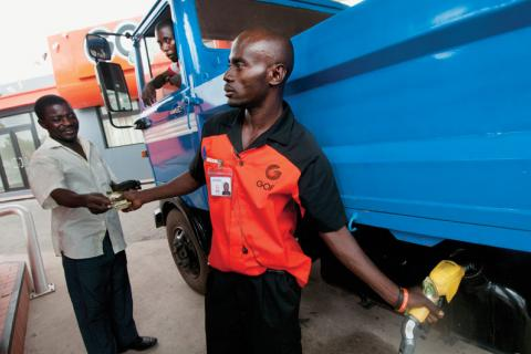 Filling a truck with diesel fuel at a Ghana Oil station in Accra