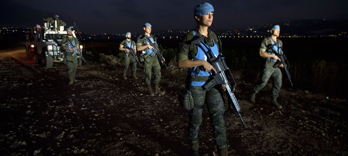 UNIFIL's Spanish peacekeepers on an evening foot patrol along the Blue Line at the outskirts of Kafar Kela, south Lebanon.