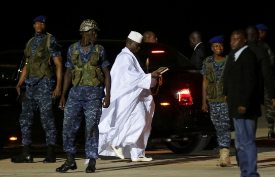 The Gambia's former president Yahya Jammeh (in white) prepares to depart from Banjul airport to exile in Guinea Bissau on January 21, 2017. Photo:Reuters/Thierry Gouegnon