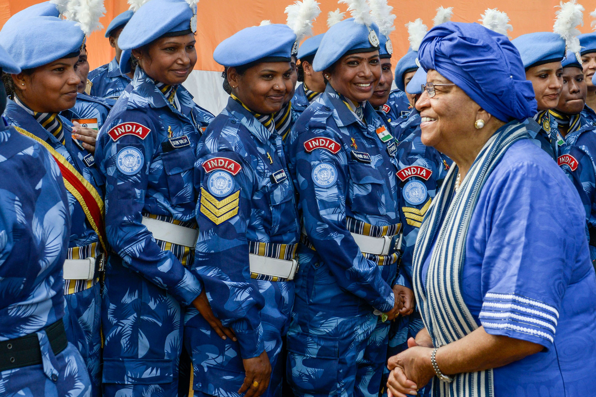 President Ellen Johnson-Sirleaf (left) with members of the all-female Indian Formed Police Unit serving with the UN Mission in Liberia. Photo: Emmanuel Tobey/UNMIL