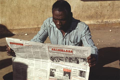 Reading a newspaper in Madagascar.
