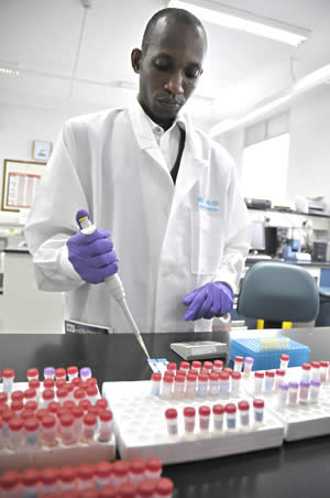 A laboratory technician at an HIV/AIDS institute in Uganda