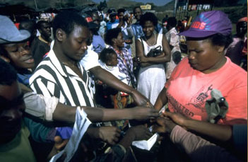 An AIDS worker distributing free condoms