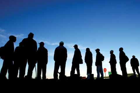 Job seekers waiting alongside a road in Cape Town, South Africa