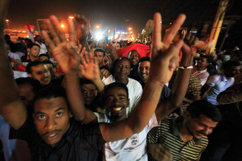 Sudanese and Egyptian residents in Khartoum, Sudan, celebrated the downfall of the Mubarak government