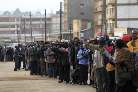 Voters queue up for a referendum on a new constitution in Kenya in 2010