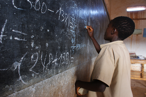 A young boy solving an equation at a primary school in Makamba, in southern Burundi