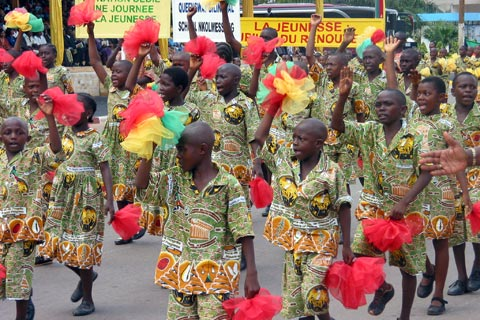 School children march in celebrations marking Cameroon's 50th anniversary