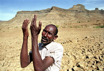 Ethiopian farmer Teshoma Abera laments the absence of rainfall