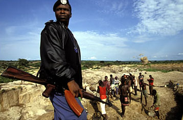 Guard at an illegal diamond mine in Angola during the country's civil war