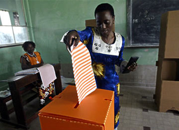 Woman voting in the Congo