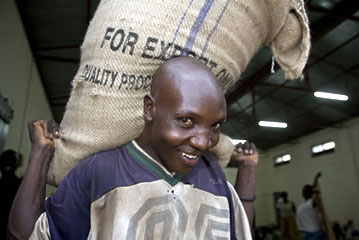 "Carrying a sack of ""export quality"" coffee in Uganda"