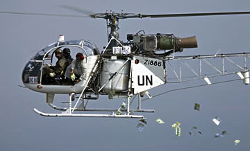 A UN helicopter drops leaflets in an area of the Congo
