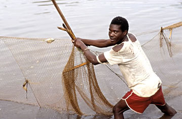 Fisherman checking a fishing a net in Uganda