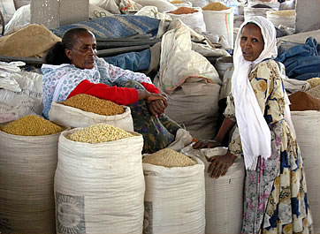 Twon women with sacks of grain