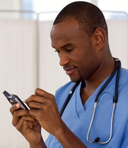 Doctor entering information into mobile phone