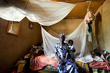 A mother and child in Ghana with insecticide-treated bed nets to protect against mosquitos carrying malaria