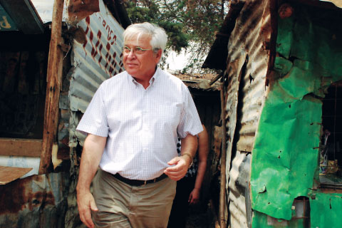 Joan Clos, executive director of UN-Habitat, visiting the Kibera slum in Nairobi, Kenya