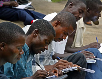 Job seekers filling out applications in Monrovia, Liberia
