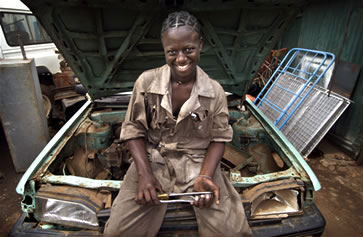 A young woman professionally trained as an auto mechanic in Kenya