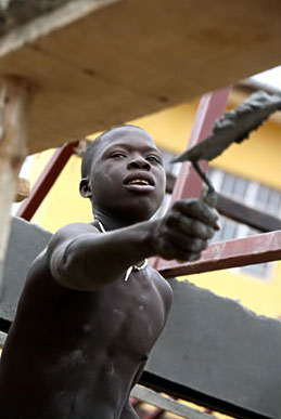 Applying cement at a construction site in Freetown, Sierra Leone