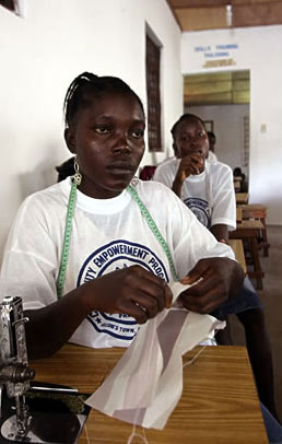 A Liberian ex-combatant at a sewing class, to improve her skills in a tight job market