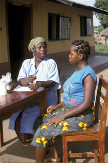 A pregnant woman gets medicine and advice at a rural clinic in Kenya