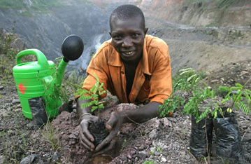 Planting new trees near a manganese mine in Ghana