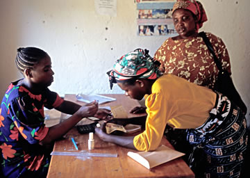 Members of a Kenyan women's dairy cooperative receiving payments
