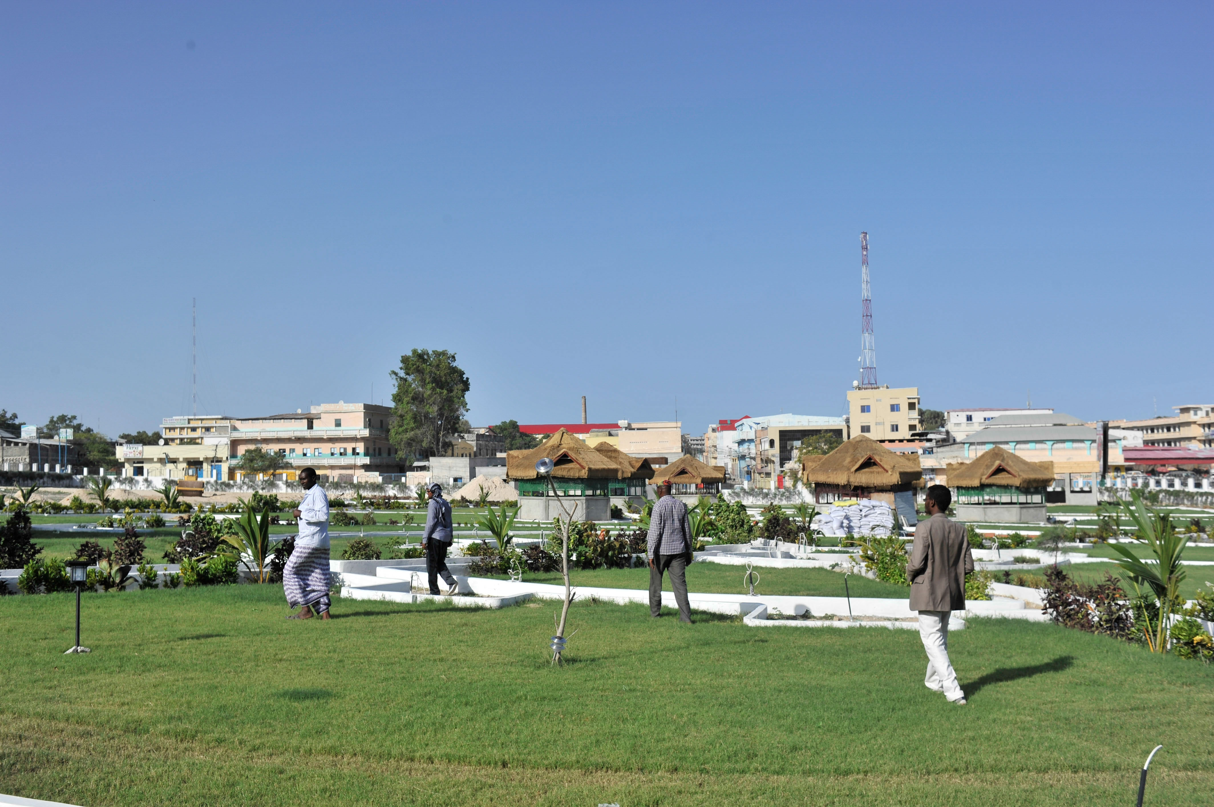From Strife To Revival Mogadishu Holds Hopes And Dreams Africa Store Gt Tv Parts Circuit Boards X Y Sc Ss Sustain Samsung People Walk Inside The Recently Opened Peace Garden In Hamar Jajab District Of