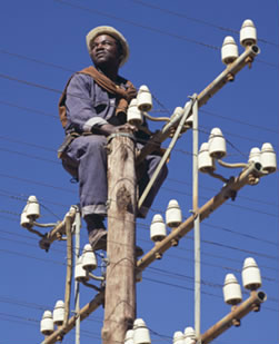 Technician on an electricity pole in Africa