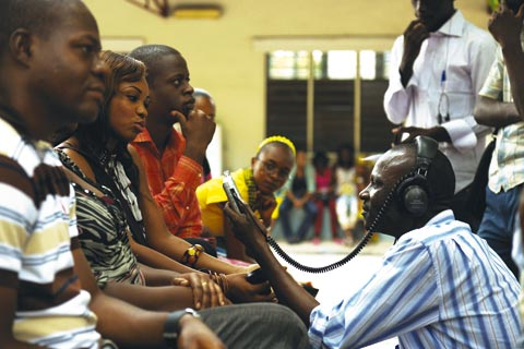 Radio Okapi reporter interviewing Congolese youths