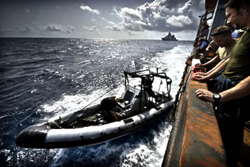 A relief ship delivering food to Somalia is protected by a Dutch warship