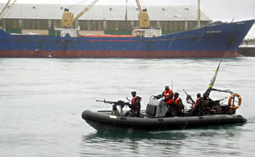 African Union forces escort a cargo ship released by Somali pirates
