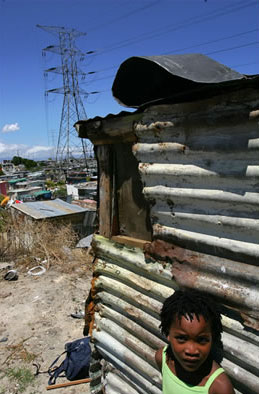 A poor neighbourhood in Cape Town, South Africa, in the shadow of a high-tension power line