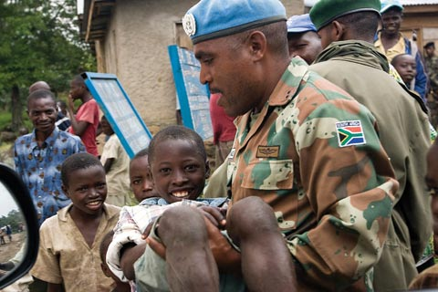 UN peacekeeper with villagers in the Democratic Republic of the Congo