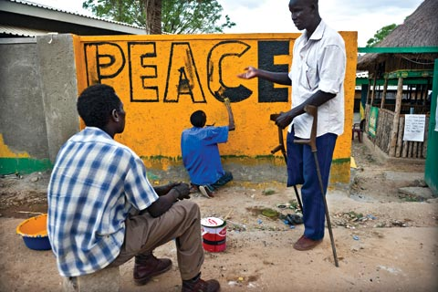 Painters decorating a wall in Juba, South Sudan