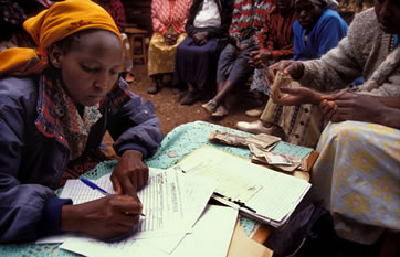 Signing up for a loan with a community group's microcredit programme in Kenya