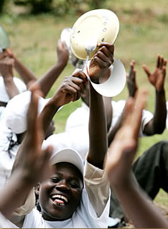 Kenyans bang spoons against plates during an October 2006