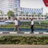 An artist impression (in the background) of a forthcoming shopping and office complex. Photo: Panos/Sven Torfinn