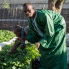 Ibrahima Sow, a Senegalese returnee, dressed up to show his work as a market gardener.
