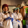 Health workers in the DRC put on gloves on before checking patients at the hospital.