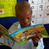 Six-year old Thobela Boyoyo is the most advanced reader in his class.