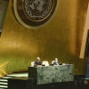 Volkan Bozkir (left at dais and on screens), President of the 75th session of the United Nations Gen
