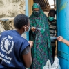 WFP staff attend to a participant in a Food and Cash assistance scheme Kano, Nigeria, last week.