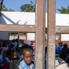 Cyclones Idai and Kenneth in Mozambique. In Beira, a boy looks through a classroom window. UN Photo/Eskinder Debebe