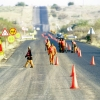 Roadworkers undertaking repairs on a World Bank funded road. Photo credit: World Bank/Trevor Samson