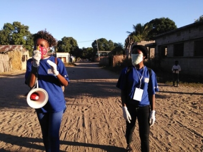Community activists take to the streets with megaphones to educate communities on gender-based violence prevention. Photo: Ophenta