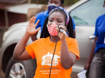 Civil society activist raises awareness on gender-based violence during a street campaign. Photo: ASCHA