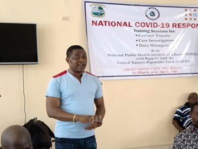 Thomas K. Nagbe, of the National Public Health Institute of Liberia, speaks at a training session for contact tracers.